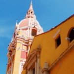 Yellow building against blue sky in Cartagena Colombia's Old City