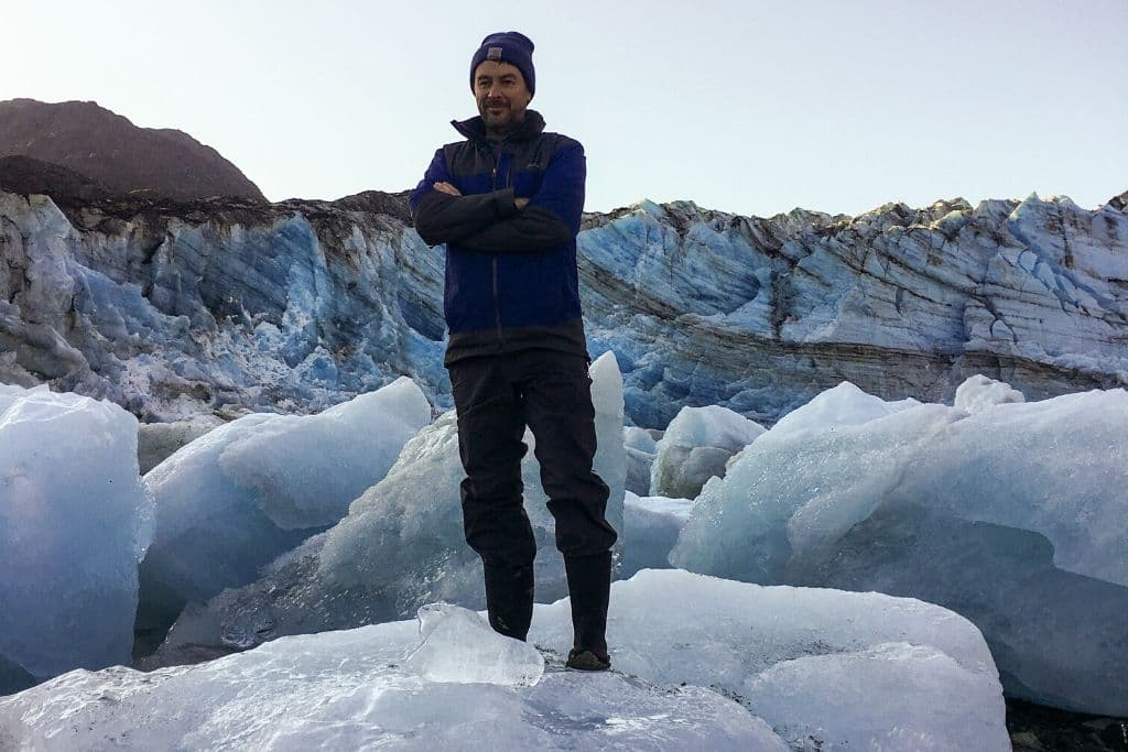 Mr. SBC standing on a large block of ice in the glacier garden