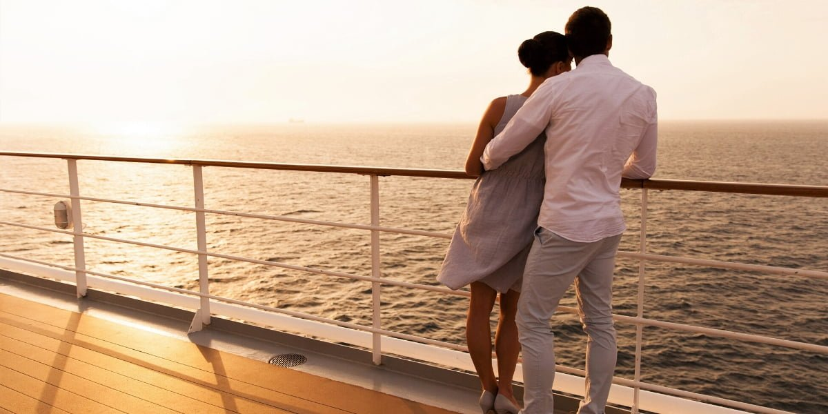 Couple embracing on a cruise ship deck