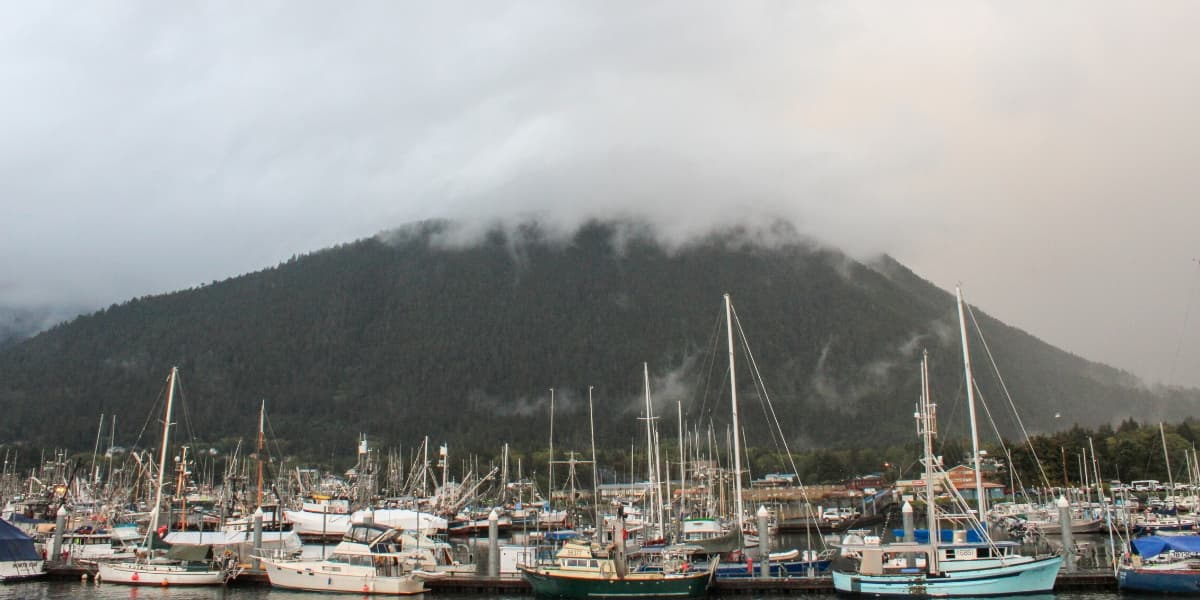 SItka Harbor with boats and misty mountain