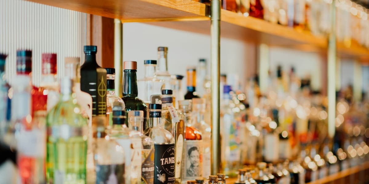 liquor bottles behind a bar