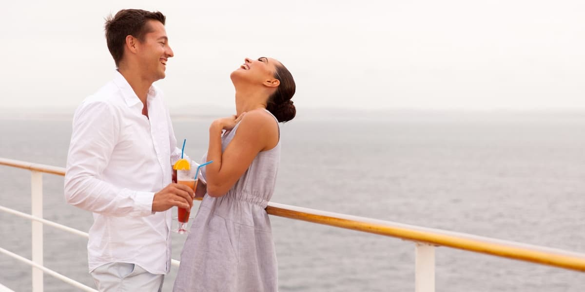 Man and woman at cruise ship railing