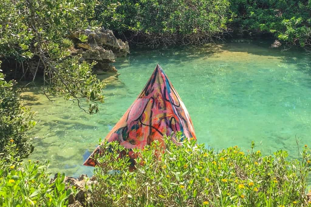 An art installation at the Blue Hole in Tom Moore's Jungle Bermuda