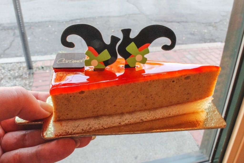 a slice of witch-themed cheesecake at Caramel Patisserie, Salem MA